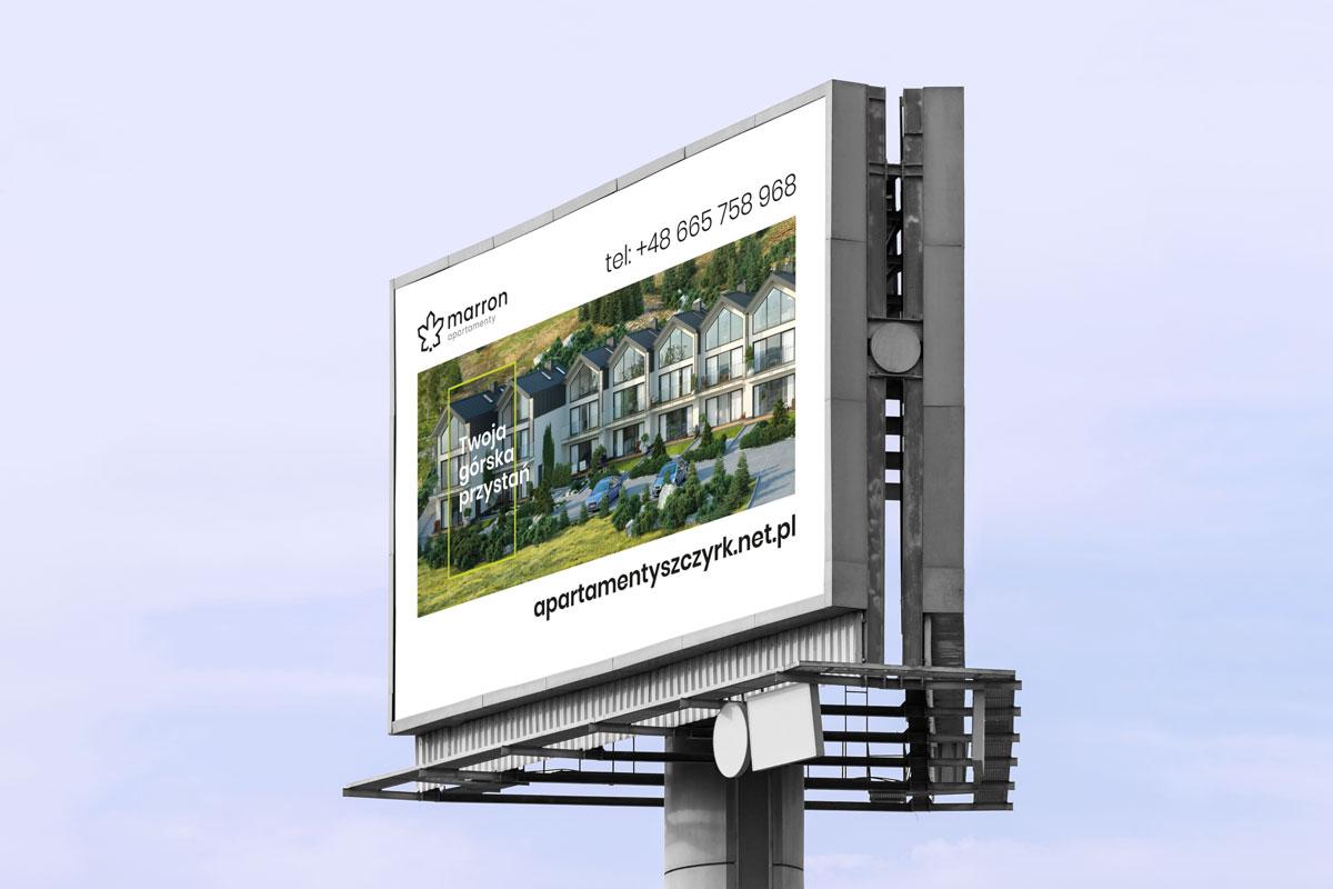 Projekt billboard'u – sygnet z logotypem Marron Apartamenty